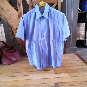 chemisette bleue taille L 41/42