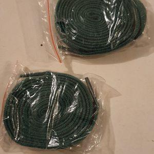 Paire de lacets neufs verts