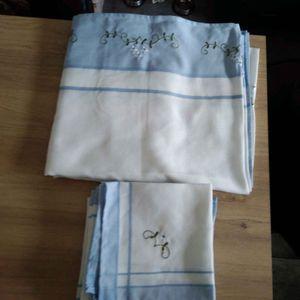 Grande nappe rectangulaire avec 8 serviettes assorties