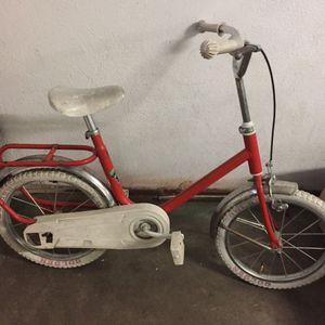 Donne joli vélo rétro à retaper
