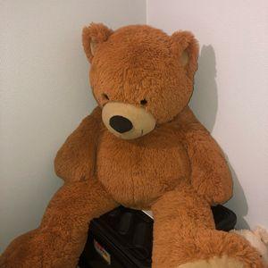 Grande peluche ours doudou