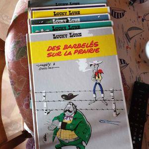 Lot de livres lucky luke et un Astérix